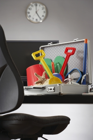 work life balance: Beach toys in open business case in office