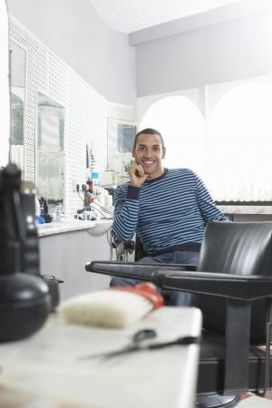 Man sitting in barbers shop smiling portrait Stock Photo - 19076119