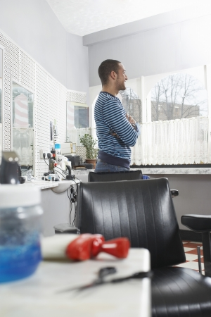 Man standing in barbers shop Stock Photo - 19076121