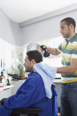Barber preparing man for haircut in barber shop Stock Photo - 19076150