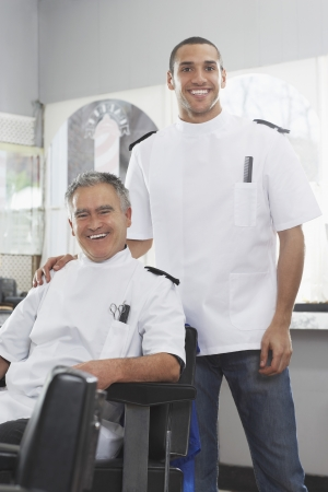 Two barbers in barber shop portrait Stock Photo - 19076179