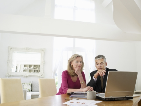 financial advisor: Woman sitting at table with financial advisor
