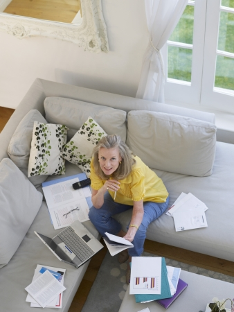 elevated view: Woman using laptop sitting on sofa elevated view