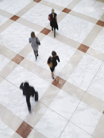 range of motion: Business people walking elevated view long exposure