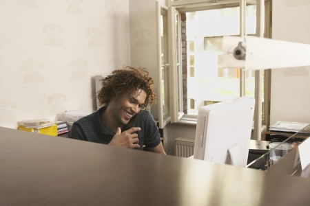 Young man using phone in office Stock Photo - 19076813
