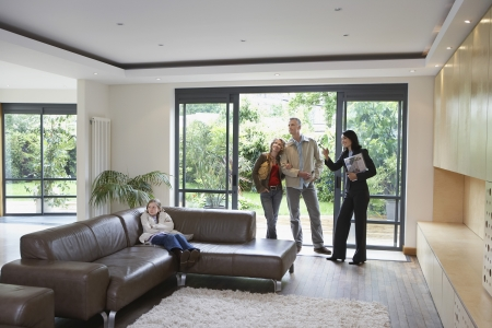 real man: Parents with bored daughter (7-9) and estate agent observing new property