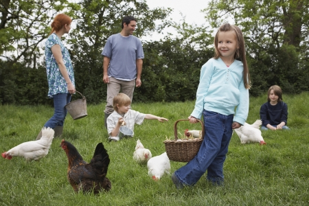 farm boys: Parents and three children (5-9) with hens in garden LANG_EVOIMAGES