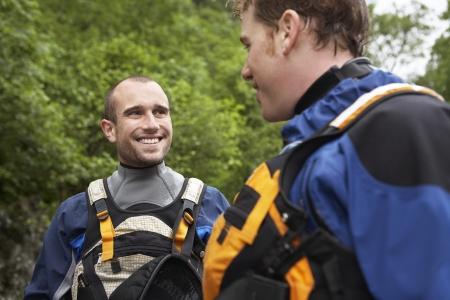 kayaker: Two men wearing wetsuits outdoors