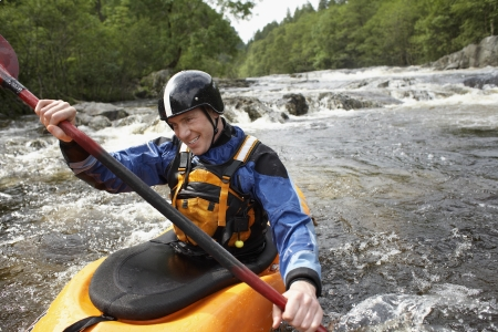 canoeing: Man kayaking in river LANG_EVOIMAGES