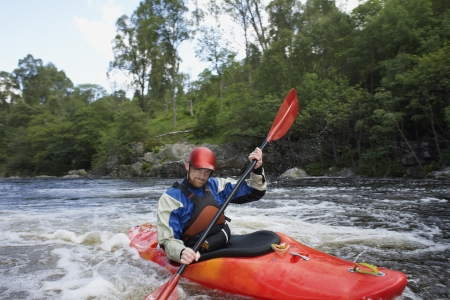 Man kayaking in river Stock Photo