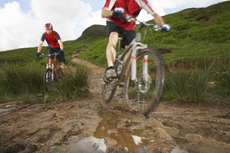 mountain biking: Two cyclists on track in countryside