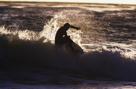 Man surfing wave silhouette Stock Photo - 19077777