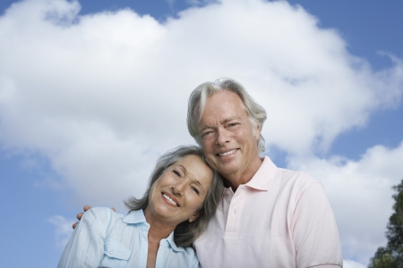 Portrait of senior couple against sky smiling Stock Photo - 19078390