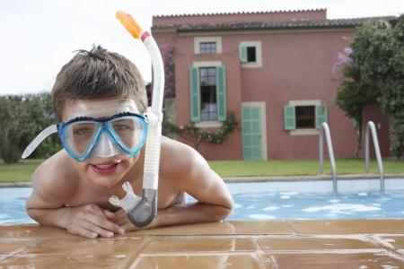 snorkelling: Portrait of boy (10-12) in pool wearing snorkelling mask