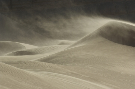 sand dune: Sand blowing over sand dune in wind
