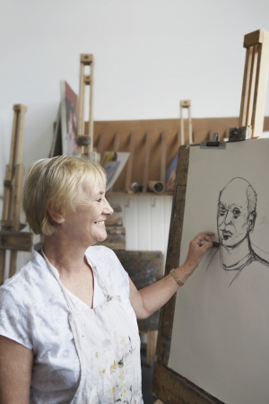 Senior woman in art class Stock Photo - 19078527
