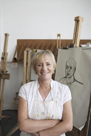 putney: Artist standing by artwork in studio portrait LANG_EVOIMAGES