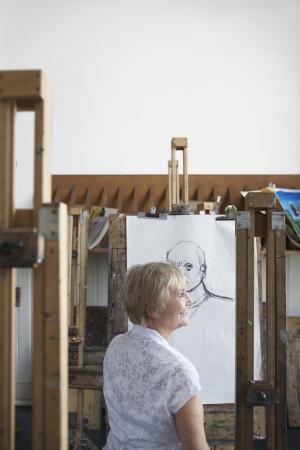 Mature woman in art studio smiling