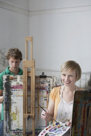 2 students painting at easels in art class Stock Photo - 19078538