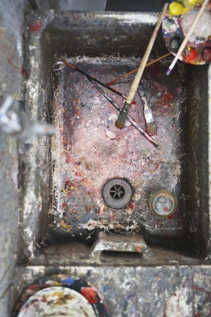 Sink with palette and paintbrushes in artist's studio view from above Stock Photo - 19078546
