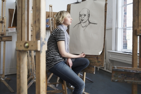 putney: Thoughtful student by charcoal portrait in art school LANG_EVOIMAGES