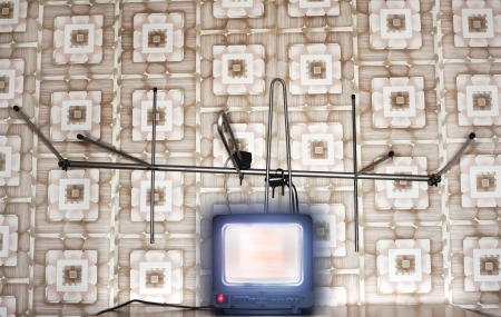Old fashioned tv set with antenna wallpaper with pattern Stock Photo - 19078626