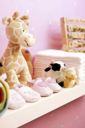 nappies: Stuffed toys shoes and nappies on shelf in babys room