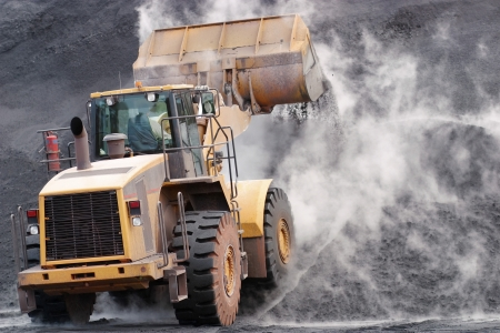 Front loader dumping mineral material on heap Stock Photo - 19078703