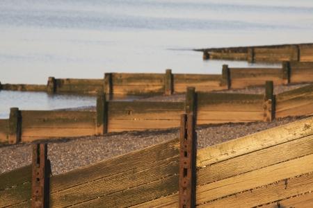 breakwaters: Wooden breakwaters on beach