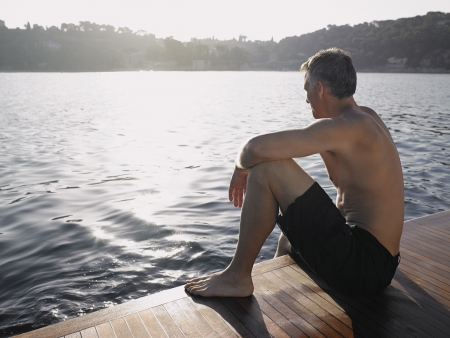 early 40s: Man Sitting by Water LANG_EVOIMAGES