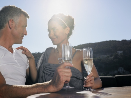 fortysomething: Couple Drinking Champaign on Boat LANG_EVOIMAGES