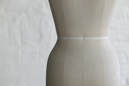 female likeness: Mannequin indoors close up mid section