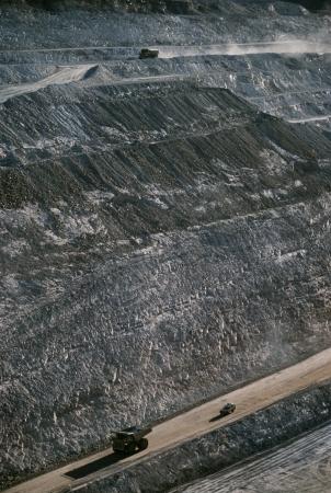 earth moving: Earth moving trucks open cut gold mine Telfer Western Australia