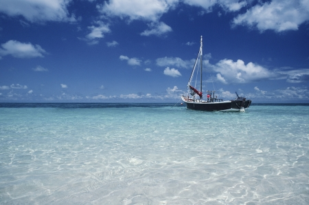 Boat moored in shallow water Far North Queensland Australia