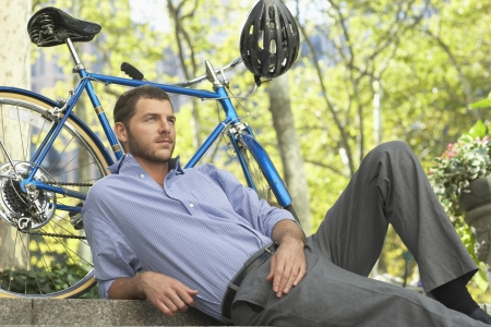 rolled up sleeves: Man relaxing in park LANG_EVOIMAGES