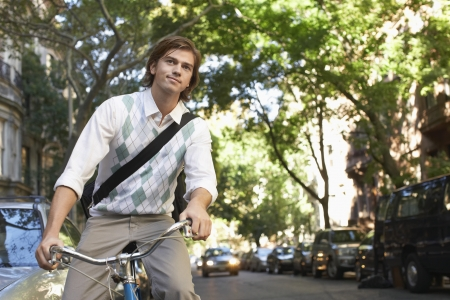 Man riding bicycle in residential district Stock Photo - 20714411