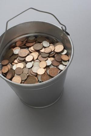 bucket of money: Bucket of coins