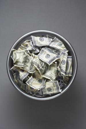 wastebasket: Dollar bills in wastebasket view from above