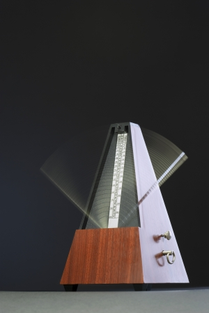 Metronome in motion Stock Photo - 20714539