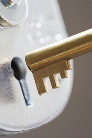 things that go together: Golden key and padlock close-up