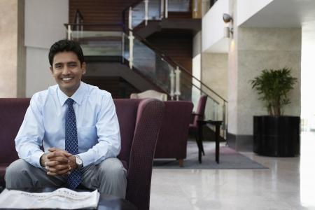 only man: Businessman sitting on sofa portrait