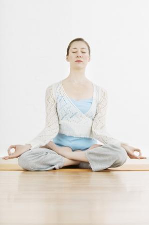 Teenage girl (16-17) performing yoga Stock Photo