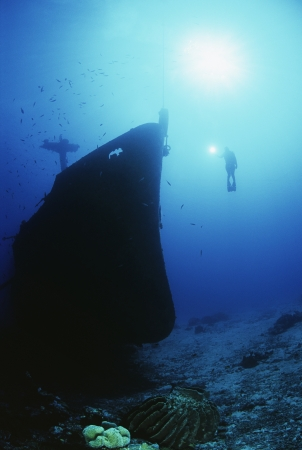 Diver exploring bow of sunken fishing trawler Stock Photo - 20715085