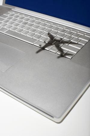 jumbo jet: Shadow of jumbo jet over apple macintosh keyboard LANG_EVOIMAGES