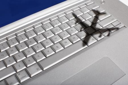 macintosh: Shadow of jumbo jet over apple macintosh keyboard LANG_EVOIMAGES