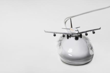 jumbo jet: Jumbo jet on apple macintosh computer mouse digital composite