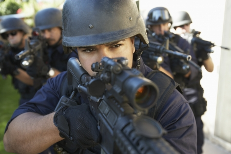 Swat officers aiming guns Stock Photo