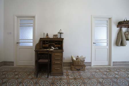Cyprus writing desk in entrance hall of 1950's town house Stock Photo - 20715365