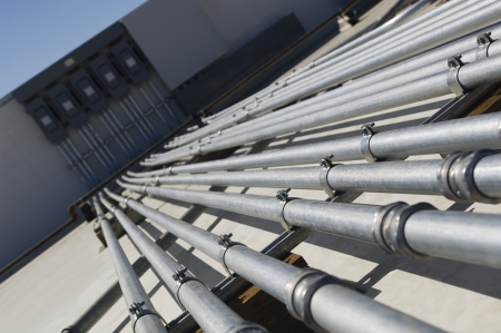 Pipes Leading to Electrical Boxes at Solar Power Plant Stock Photo - 20715684