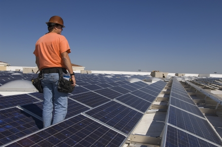 electrical engineer: Electrical Engineer Among Solar Panels at Solar Power Plant